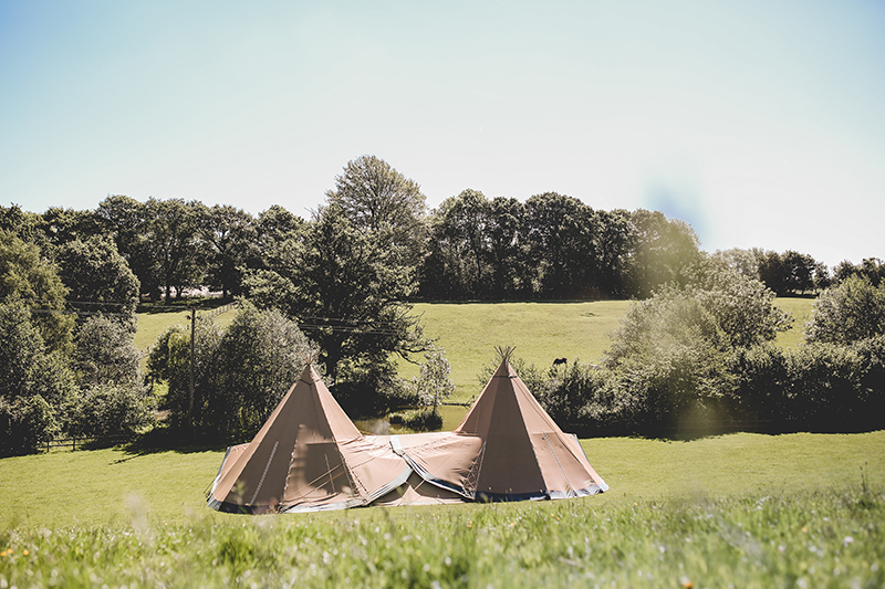Two Tipis Overlooking Lake